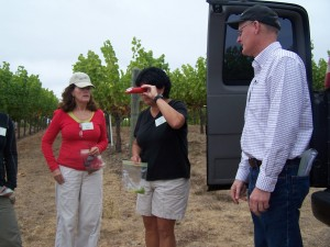 Wine Boot Camp recruits use a refractometer at Chalk Hill